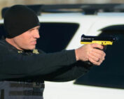 Tulsa Police officer using a new Pepper Ball Launcher - Photo courtesy of Stetson Payne, Tulsa World